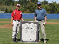 Head Coach Jedd Soto giving a team jersey to Joe Peterson, brother of Jeff. Courtesy: SMC Athletics