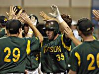 George Mason's Scott Krieger celebrates one of his four home runs in last year's CAA Tournament.