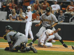 Texas' Brandon Belt (13) scores on a wild pitch-Rod Aydelotte photo