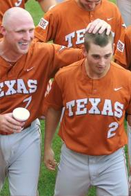 Texas' Travis Tucker gets a pat on the head from catcher Preston Clark after his grand slam off Baylor's Aaron Miller in the second inning.-Rod Aydelotte WACO TRIBUNE HERALD